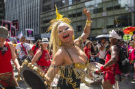 Juliana Moraes dances to the music at the Queer Liberation March on Sunday, June 27, 2021, in New York. (AP Photo/Brittainy Newman)