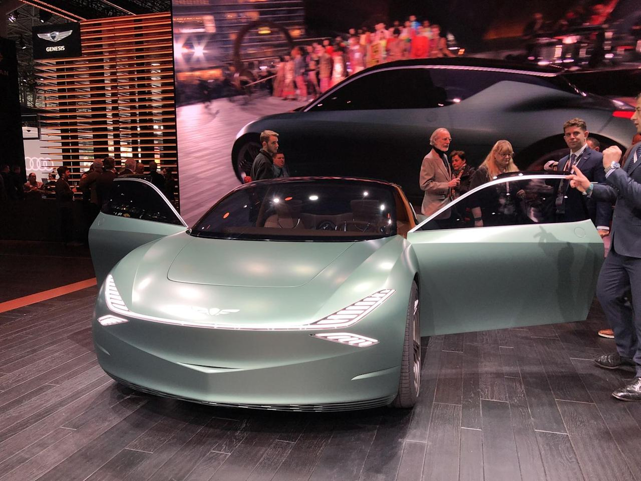 """<p>Let us take a moment to praise one of the greatest-nay, <em>the</em> greatest-auto show tradition, and that is bizarre concept cars that automakers have no intention of making. </p><p>And the best of New York 2019 might be the <a href=""""https://www.roadandtrack.com/car-shows/new-york-auto-show/a27168704/genesis-mint-concept-new-york-auto-show/"""">Mint Concept by Genesis</a> (the Hyundai car became its own brand a few years ago). This bright green design exercise has everything you could want: electric power, weird sunken door button, a charging port curiously located on the back of the car, gullwing back doors, and a sci-fi daydream interior. </p><p>Genesis won't actually build this car, but it's smart to imagine a design direction for city dwellers who want a vehicle that barely resembles today's anonymous crossovers.</p>"""