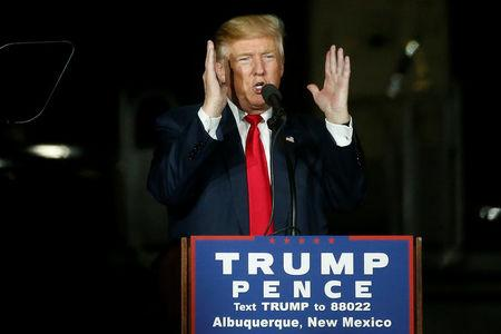 Republican presidential nominee Donald Trump speaks at an airport campaign rally in Albuquerque,