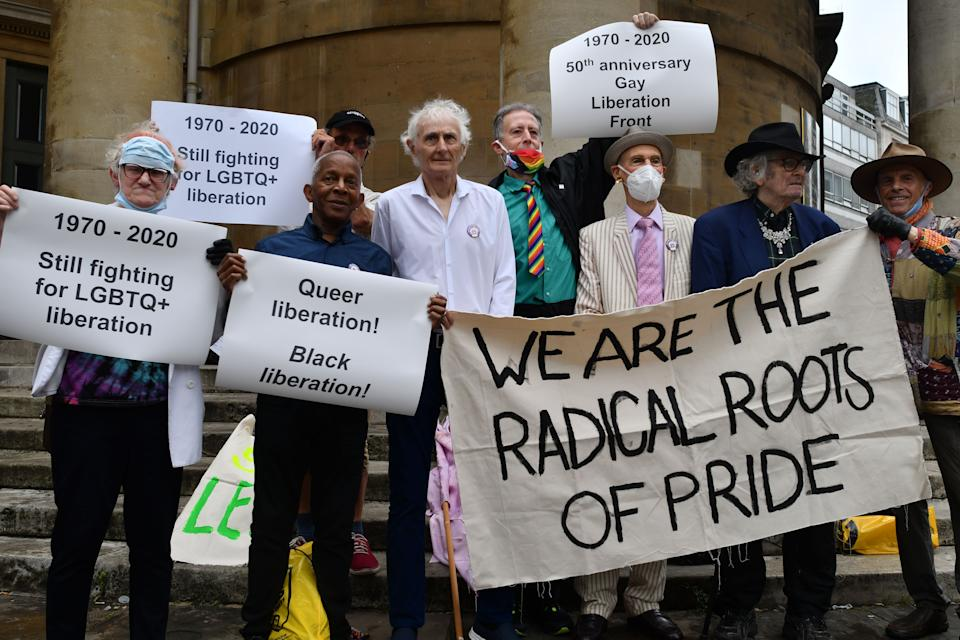 British gay rights activist Peter Tatchell (C green shirt) poses with London Gay Liberation Front veteran campaigners and supporters during a march to mark the 50th anniversary of the London Gay Liberation Front's formation in 1970 in London on June 27, 2020. (Photo by JUSTIN TALLIS / AFP via Getty Images)