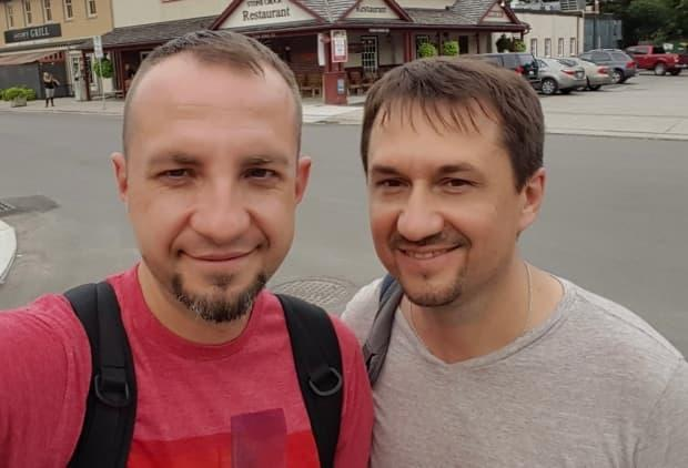 Denis Varaka, 43, left, and Vlad Bobko, 45, right, travelled to Russia a few months ago to look after Varaka's sick father. There, they each decided to take Russia's COVID-19 vaccine, Sputnik V. Now, Varaka says his job as a nurse at Toronto General Hospital is in jeopardy because the vaccine he received isn't approved in Canada.  (Denis Varaka - image credit)