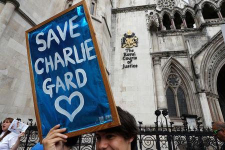 People campaign to show support for allowing Charlie Gard to travel to the United Stated to receive further treatment, outside the High Court in London, Britain July 13, 2017. REUTERS/Peter Nicholls