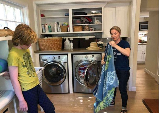 Oona Hanson shows her kids how to fold laundry during 'Common Sense Camp.' (Oona Hanson)