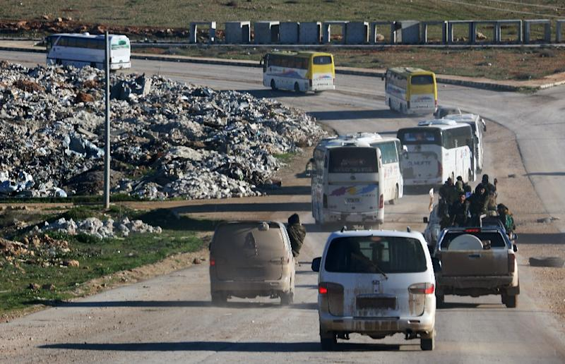 Rebel vehicles and buses of Syrians evacuated from Waer, the last opposition-held district of Homs, arrive in the northern Syrian town of Al-Bab on March 19, 2017 (AFP Photo/Zein Al RIFAI)