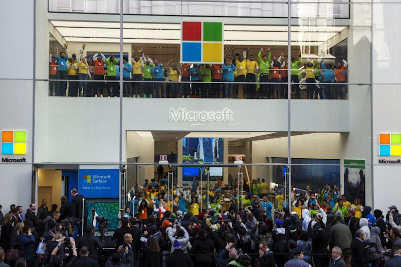 Store employees jump and cheer for the grand opening of a flagship Microsoft Corp. retail store in New York, October 26, 2015. REUTERS/Lucas Jackson
