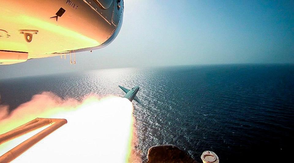 Iran's paramilitary Revolutionary Guard fired a missile from a helicopter targeting a replica aircraft carrier (AP)