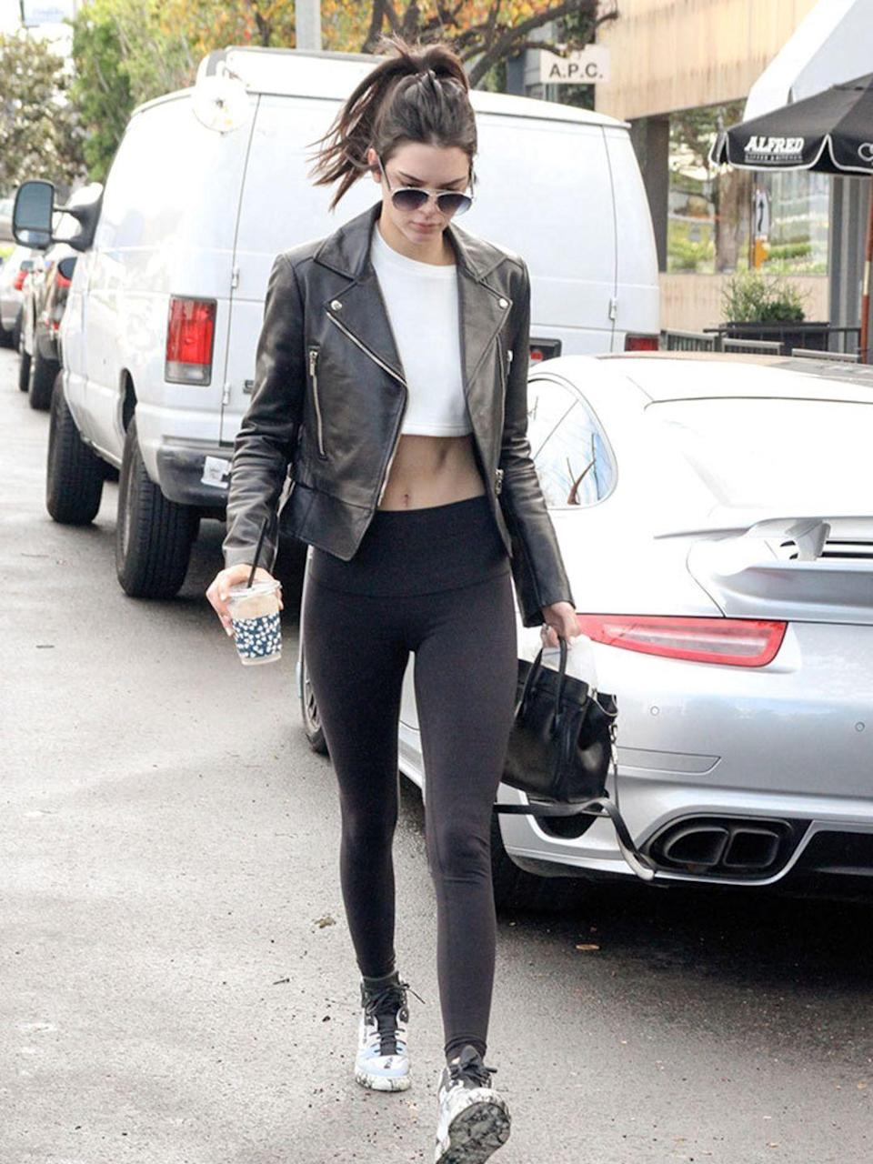<p>Kendall Jenner takes the athleisure trend to a whole new level in her leather and leggings combination. </p>