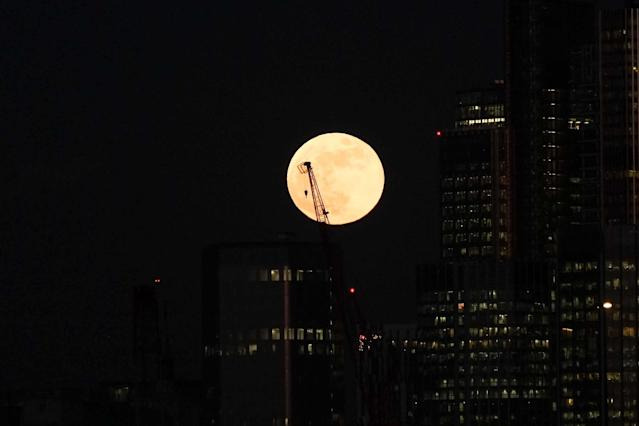 A blue super moon rises over the City of London on 31 January 31, 2018. (PA)