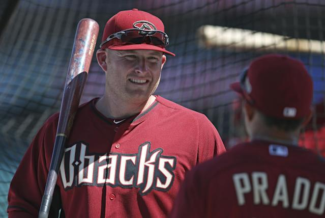 Arizona Diamondbacks' Mark Trumbo, left, and Marin Prado chat each other during batting practice at the Sydney Cricket Ground in Sydney, Thursday, March 20, 2014. The Diamondbacks and the Los Angeles Dodgers open their MLB regular season with baseball games on Saturday and Sunday. (AP Photo/Rick Rycroft)