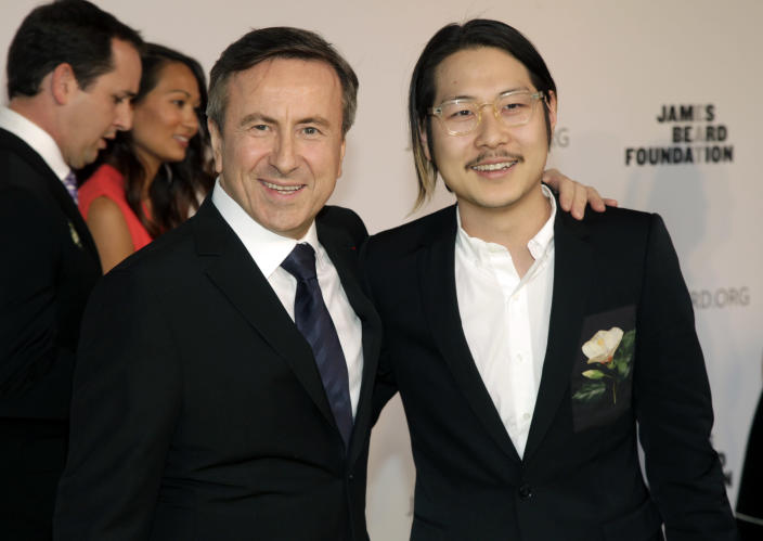 Restaurateurs Daniel Boulud, left, and Danny Bowien, right, attend the 2014 James Beard Foundation Awards on Monday, May 5, 2014, in New York. (Photo by Andy Kropa/Invision/AP)