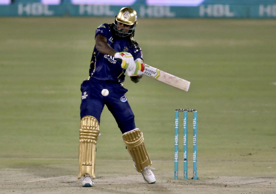 Quetta Gladiators' Chris Gayle plays a shot during a Pakistan Super League T20 cricket match between Lahore Qalandars and Quetta Gladiators at the National Stadium, in Karachi, Pakistan, Monday, Feb. 22, 2021. (AP Photo/Fareed Khan)