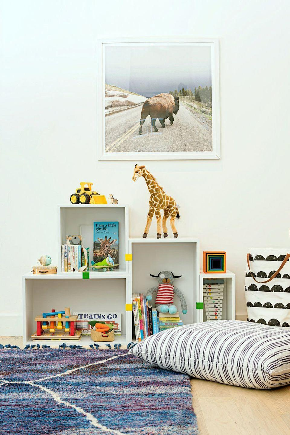 <p>Decorate from a kid's perspective, especially if your little one is still little—like literally get on your hands and knees to see what height their toys and furniture should reach. Even the artwork in this cute playroom designed by Regan Baker is scaled at a lower level to accomodate kids. </p>