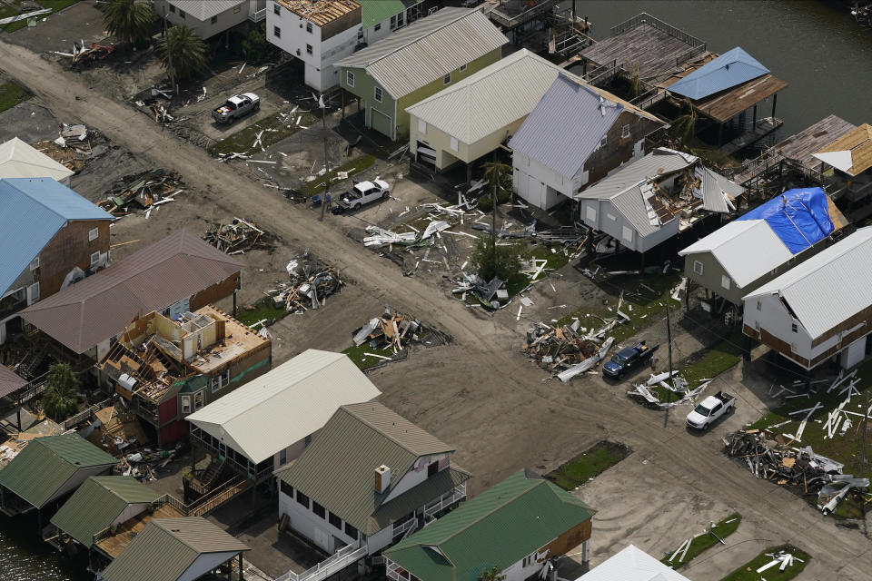 In this aerial photo, the remains of damaged homes are seen in the aftermath of Hurricane Ida, Monday, Sept. 6, 2021, in Golden Meadow, La. (AP Photo/Matt Slocum)