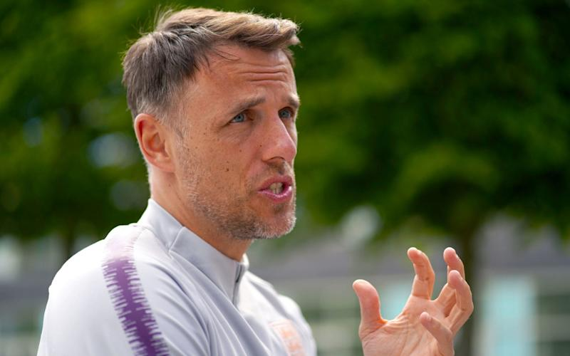 Phil Neville says he will not ban his England players from social media during the World Cup - PA
