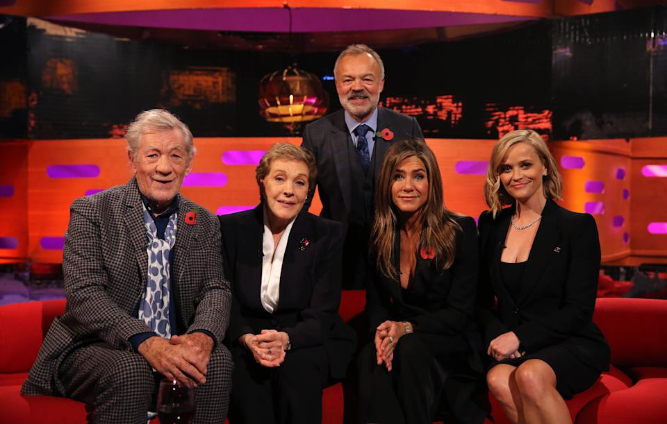 Host Graham Norton with (seated left to right) Ian McKellen, Julie Andrews, Jennifer Aniston and Reese Witherspoon during the filming for the Graham Norton Show at BBC Studioworks 6 Television Centre, Wood Lane, London, to be aired on BBC One on Friday evening. (Photo by Isabel Infantes/PA Images via Getty Images)