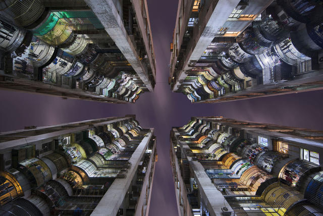<p>The pictures show the Chinese city from a vertical perspective, making the towering skyscrapers look never-ending. (Photo: Romain Jacquet-Lagreze/Caters News) </p>