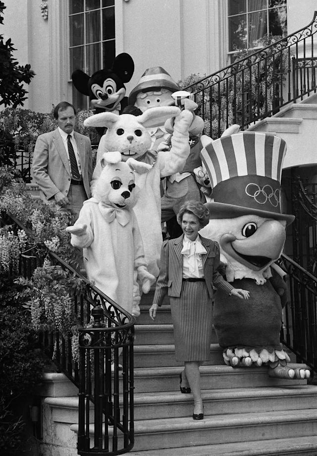 <p>First lady Nancy Reagan leads a group of cartoon characters to the South Lawn of the White House Monday for the annual Easter Egg Roll, April 20, 1981. (Photo: Barry Thumma/AP) </p>