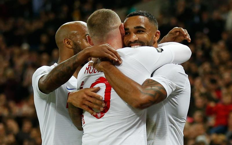 Callum Wilson celebrates making it England 3 USA 0 with Wayne Rooney on his farewell appearance. - AFP