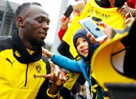 Soccer Football - Usain Bolt participates in a training session with Borussia Dortmund - Strobelallee Training Centre, Dortmund, Germany - March 23, 2018 Usain Bolt with fans after Borussia Dortmund training REUTERS/Thilo Schmuelgen