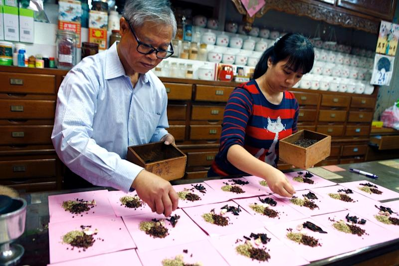 Traditional medicine stores are dying out in Taiwan due to a licensing law, despite remaining wildly popular (AFP Photo/HSU Tsun-hsu)
