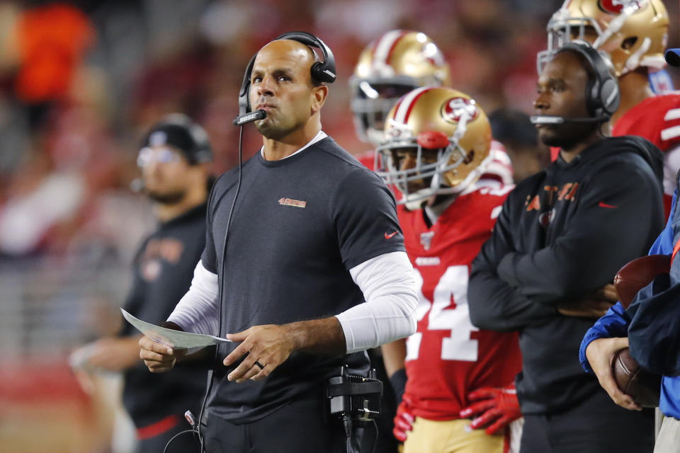 FILE - In this Dec. 21, 2019, file photo, San Francisco 49ers defensive coordinator Robert Saleh watches during the first half of the team's NFL football game against the Los Angeles Rams in Santa Clara, Calif. The Kansas City Chiefs have perhaps the most dynamic offense in the NFL and the 49ers feature one of the stingiest defenses in the league. The men in charge of the units got interviews for head coaching positions but were passed over. (AP Photo/John Hefti, File)