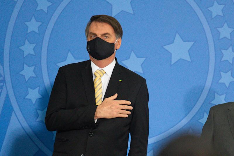 BRASILIA, BRAZIL - MAY 15: President of Brazil Jair Bolsonaro reacts during launch a new campaign against domestic violence amidst the coronavirus (COVID-19) pandemic at the Planalto Palace on May 15, 2020 in Brasilia. Brazil has over 202,000 confirmed positive cases of Coronavirus and 13,993 deaths. (Photo by Andressa Anholete/Getty Images)