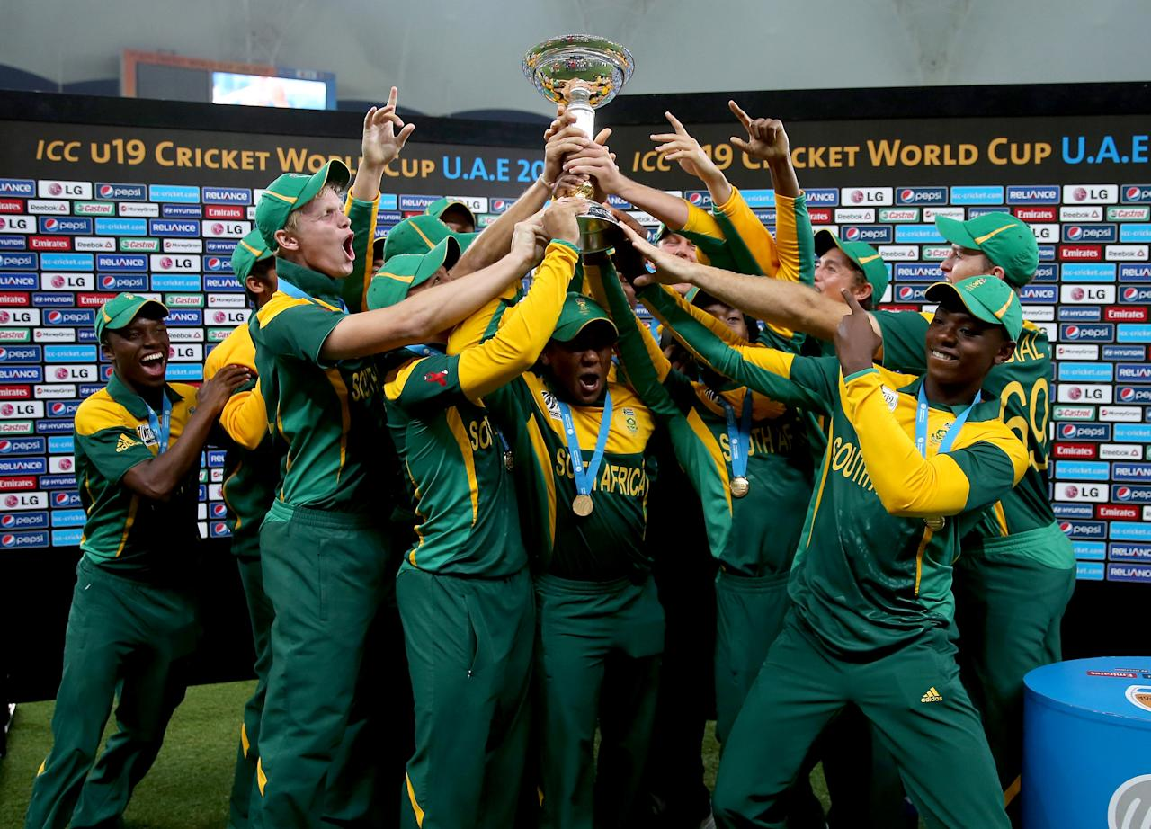 DUBAI, UNITED ARAB EMIRATES - MARCH 01:  South Africa celebrate after winning the ICC U19 Cricket World Cup 2014 Super League Final match between South Africa and Pakistan at the Dubai Sports City Cricket Stadium on March 1, 2014 in Dubai, United Arab Emirates.  (Photo by Francois Nel - IDI/IDI via Getty Images)