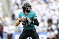 Coastal Carolina quarterback Grayson McCall (10) looks to pass during the first half of a NCAA college football game against Buffalo in Buffalo, N.Y. on Saturday, Sept. 18, 2021. (AP Photo/Joshua Bessex)