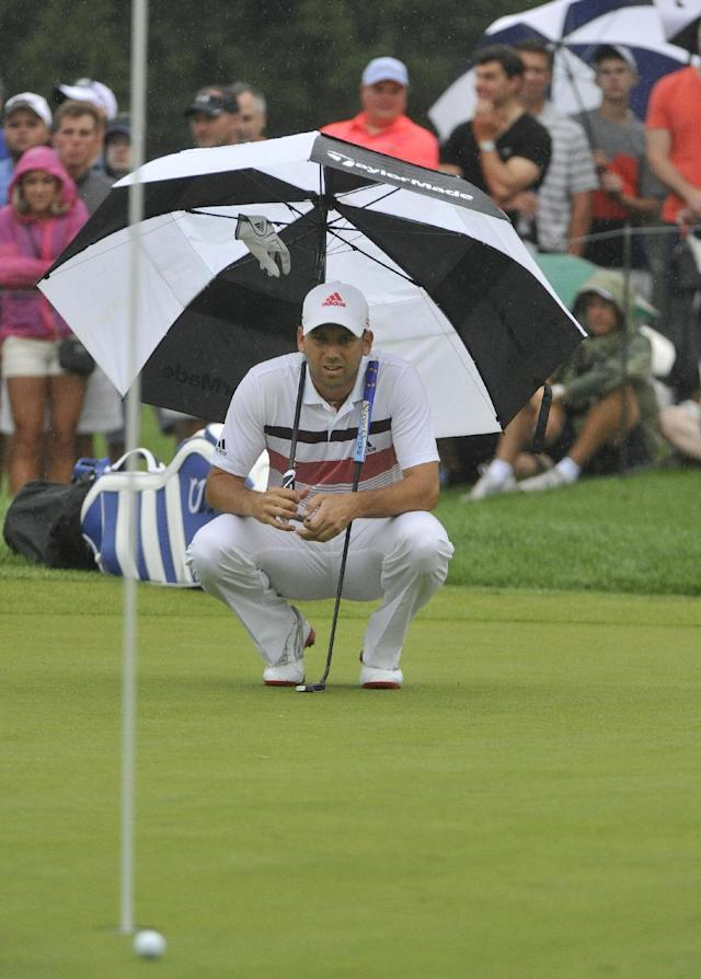 Sergio Garcia looks over the line for his putt, during the third round of the Bridgestone Invitational golf tournament, Saturday Aug. 2, 2014, in Akron, Ohio. (AP Photo/Phil Long)