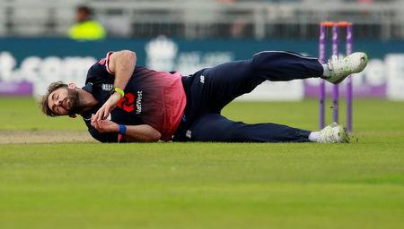Cricket - England vs West Indies - First One Day International - Emirates Old Trafford, Manchester, Britain - September 19, 2017    England's Liam Plunlett falls over   Action Images via Reuters/Jason Cairnduff     TPX IMAGES OF THE DAY