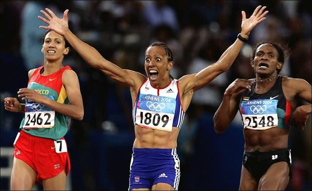 Dame Kelly Holmes, centre, celebrates her 800m win in Athens
