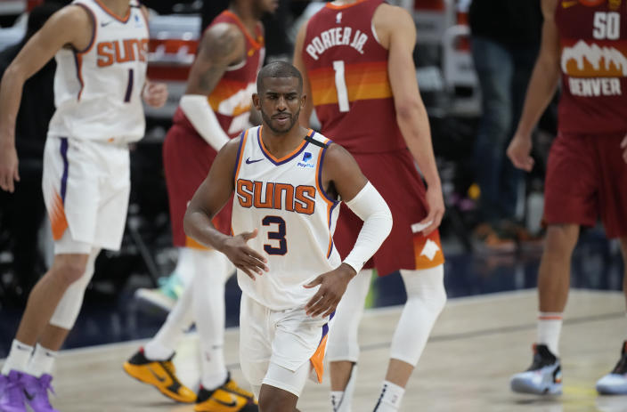 Phoenix Suns guard Chris Paul, front, reacts after hitting a basket late in the second half of Game 4 of an NBA second-round playoff series against the Denver Nuggets, Sunday, June 13, 2021, in Denver. Phoenix won 125-118 to sweep the series. (AP Photo/David Zalubowski)