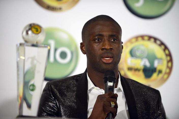 Ivorian skipper Yaya Toure speaks after receiving the CAF African Footballer of the Year Award in Lagos on January 8, 2015 (AFP Photo/Pius Utomi Ekpei)