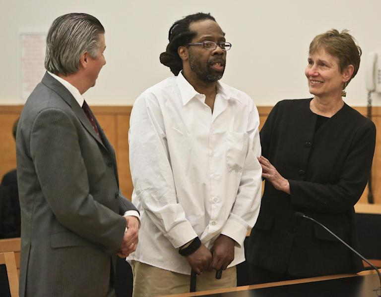 Robert Hill, center, stands with his lawyers Harold Ferguson, left, and Sharon Katz, right, as Justice Neil Firetog declared him exonerated in Brooklyn Supreme Court, Tuesday May 6, 2014 in New York. Prosecutors in Brooklyn asked to throw out the decades-old convictions of three half-brothers who were investigated by homicide detective Louis Scarcella, whose tactics have come into question. The defendants, Hill, Alvena Jennette and Darryl Austin became the first people connected to the detective to be exonerated. (AP Photo/Bebeto Matthews)