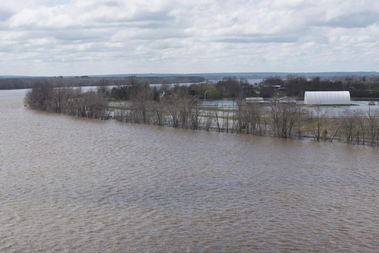 <p>This view from the Burton Bridge in Maugerville 20 minutes south of Fredericton shows how the waters of the St. John River are flooding the highway and farmland in the area on Sunday, May 7, 2017. Photo from CP Images </p>