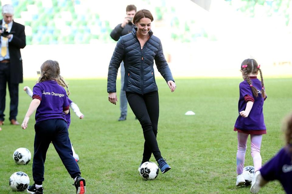 Kate Middleton plays soccer with young girls while visiting the National Stadium Belfast, home of the Irish Football Association in Belfast, Northern Ireland. (Photo: Kelvin Boyes/Press Eye/Getty Images)