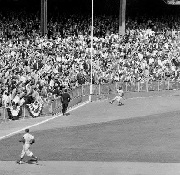"""<p><strong>October 4, 1955</strong>: In the decisive Game 7 of the '55 Fall Classic, a speedy little outfielder named Sandy Amoros helps his Dodgers win the title—and gives a legendary Yankees catcher fits in the process. The Dodgers, holding a 2-0 lead over the Yanks, send Amoros into left field in the sixth inning. With runners on first and second, Yogi Berra slices a line drive down the left-field line, confident that he pulled it enough to tie the game. But Amoros streaks across the outfield, grabs the ball with his right arm fully extended, and fires it into the infield to double up Berra and Gil McDougald. """"That was the exclamation point for the Dodgers, who went on to win their first and only world championship in Brooklyn,"""" says Frommer.<br> </p>"""