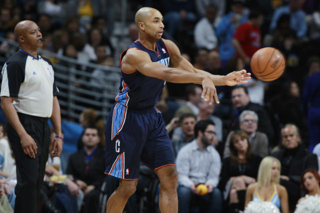 Charlotte Bobcats guard Gerald Henderson passes ball against the Denver Nuggets in the third quarter of the Bobcats' 101-98 victory in an NBA basketball game in Denver on Wednesday, Jan. 29, 2014. (AP Photo/David Zalubowski)