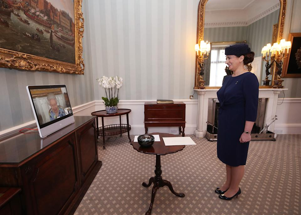 Queen Elizabeth II appears on a screen by videolink from Windsor Castle, where she is in residence, during a virtual audience to receive Her Excellency Ivita Burmistre, the Ambassador of Latvia, at Buckingham Palace, London. Picture date: Tuesday April 27, 2021.
