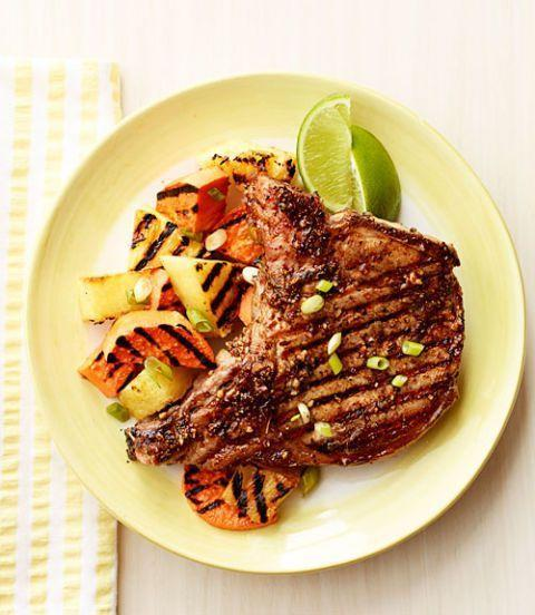 """<p>It only takes 20 minutes to transport yourself to the islands with this insanely delicious jerk pork chops dish.</p><p><em><a href=""""https://www.womansday.com/food-recipes/food-drinks/recipes/a39592/jerk-pork-chops-with-grilled-pineapple-recipe-ghk0913/"""" rel=""""nofollow noopener"""" target=""""_blank"""" data-ylk=""""slk:Get the Jerk Pork Chops with Grilled Pineapple recipe."""" class=""""link rapid-noclick-resp"""">Get the Jerk Pork Chops with Grilled Pineapple recipe.</a></em></p>"""