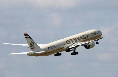 FILE PHOTO: An Etihad Airways Boeing 777-3FX aircraft takes off at the Charles de Gaulle airport in Roissy, France, August 9, 2016. REUTERS/Jacky Naegelen/File Photo