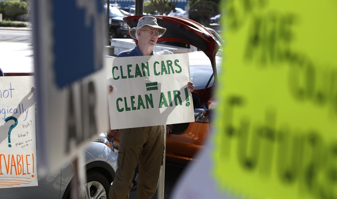 Paul Gipe protests before the first of three public hearings on the Trump administration's proposal to roll back car-mileage standards in a region with some of the nation's worst air pollution Monday, Sept. 24, 2018 in Fresno, Calif. The day-long session by the U.S. Environmental Protection Agency and National Highway Traffic Safety Administration is a means to gather public comment concerning the mileage plan, which would freeze U.S. mileage standards at levels mandated by the Obama administration for 2020, instead of letting them rise to 36 miles per gallon by 2025. (AP Photo/Gary Kazanjian)