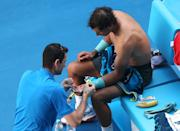 Rafael Nadal of Spain receives medical treatment to a blister on his hand during his quarterfinal against Grigor Dimitrov of Bulgaria at the Australian Open tennis championship in Melbourne, Australia, Wednesday, Jan. 22, 2014.(AP Photo/Eugene Hoshiko)