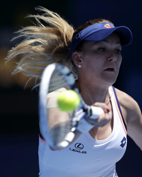 Agnieszka Radwanska of Poland makes a forehand return during her quarterfinal against Victoria Azarenka of Belarus at the Australian Open tennis championship in Melbourne, Australia, Wednesday, Jan. 22, 2014.(AP Photo/Rick Rycroft)