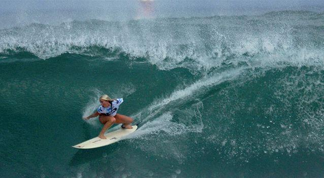 Bethany Hamilton surfs in the Roxy Pro women's surf competition in Haleiwa, Hawaii in 2005, more than a year after losing her arm. Photo: AP