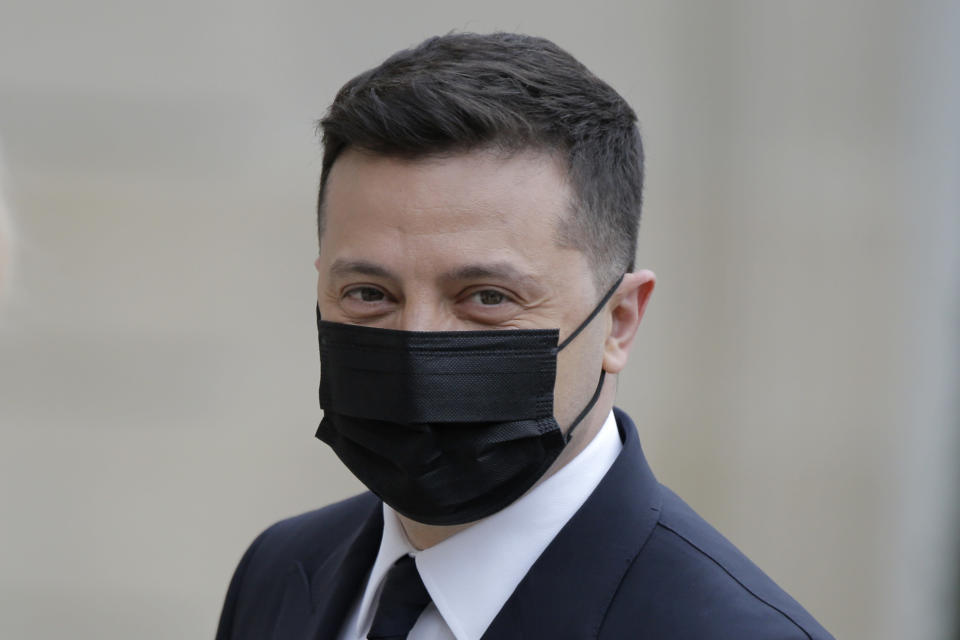 Ukrainian President Volodymyr Zelenskyy arrives for a working lunch with French President Emmanuel Macron at the Elysee palace in Paris, Friday, April 16, 2021. Ukrainian President Volodymyr Zelenskyy is holding talks with French President Emmanuel Macron and German Chancellor Angela Merkel amid growing tensions with Russia, which has deployed troops at the border with the country. (AP Photo/Lewis Joly)