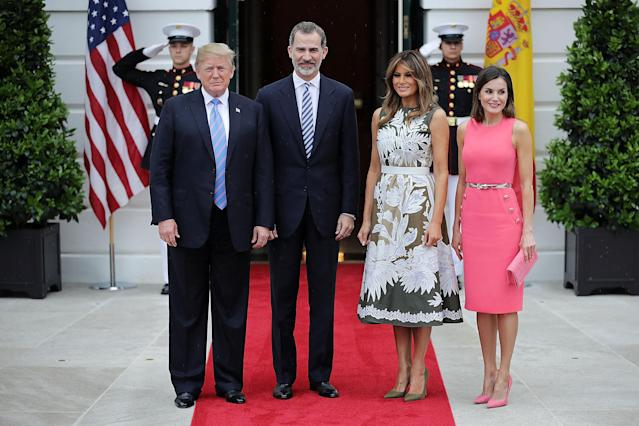 <p>Standing alongside her husband, King Felipe VI and Queen Letizia of Spain for the Spanish royal visit, Melania wore a stunning Valentino olive green dress with intricate white floral embroidery, accessoritisng with a white crocodile belt and Manolo Blahniks.<br>[Photo: Getty] </p>