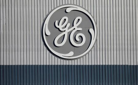 FILE PHOTO: The logo of U.S. conglomerate General Electric is pictured at the company's site of its energy branch in Belfort, France, February 5, 2019. REUTERS/Vincent Kessler