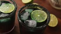 """<p>Bring a little bit of spook to your favorite tequila cocktail with food coloring and some black sanding sugar.</p><p>Get the recipe from <a href=""""https://www.delish.com/cooking/recipe-ideas/a28554448/frozen-tequila-sunrise-margarita-recipe/"""" rel=""""nofollow noopener"""" target=""""_blank"""" data-ylk=""""slk:Delish"""" class=""""link rapid-noclick-resp"""">Delish</a>. </p>"""