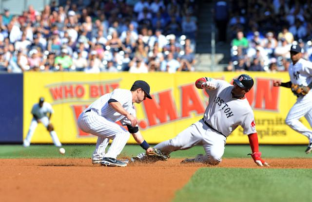 NEW YORK, NY - AUGUST 18: Carl Crawford #13 of the Boston Red Sox steals second base past the glove of Jayson Nix #17 of the New York Yankees in the first inning at Yankee Stadium on August 18, 2012 in the Bronx borough of New York City. (Photo by Jason Szenes/Getty Images)